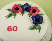 'Anemone Cake' - The flowers are made using our 'Large Christmas Rose' with leaves from our 'Large Daisy Set'. The '60' is from our 'Large Numerals' set. Set'